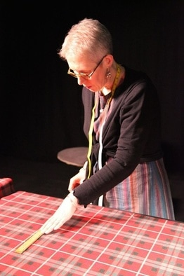 Kiltmaker Lesley Thornton marking out a kilt - Crimson Kilts